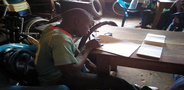 Jokene Geoffry of Tam Anyim Youth Entereprise working on his business plan