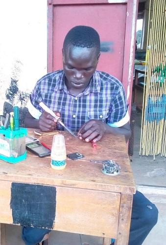 Oloya Kenneth at his workshop